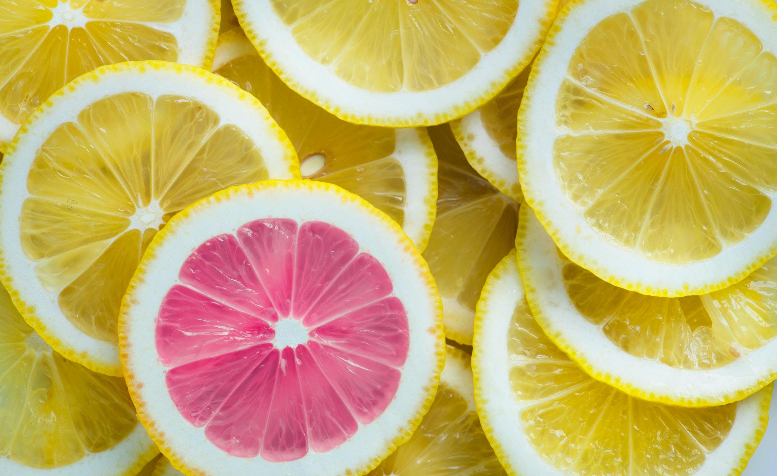 planning and thinking differently concept using lemons and a pink grapefruit